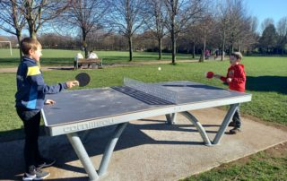 Two boys playing table tennis on the new permanent table tennis table in Millennium Park in Nailsea